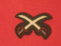 NUMBER 2 DRESS FAD CROSSED SWORDS BADGE