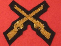 NUMBER 1 DRESS CROSSED RIFLES SKILL AT ARMS GOLD ON DARK BLUE BADGE