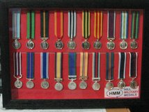 FRAMED MINIATURE MEDAL DISPLAY SET OF 20 CURRENT MEDALS.