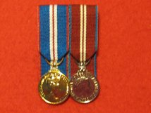 MINIATURE COURT MOUNTED GOLDEN JUBILEE AND DIAMOND JUBILEE PAIR OF MEDALS