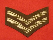 NUMBER 2 DRESS FAD 2 BAR CPL CHEVRON ON FAD BROWN BADGE
