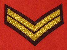 MESS DRESS 2 BAR CORPORAL CHEVRON GOLD ON MAROON BADGE